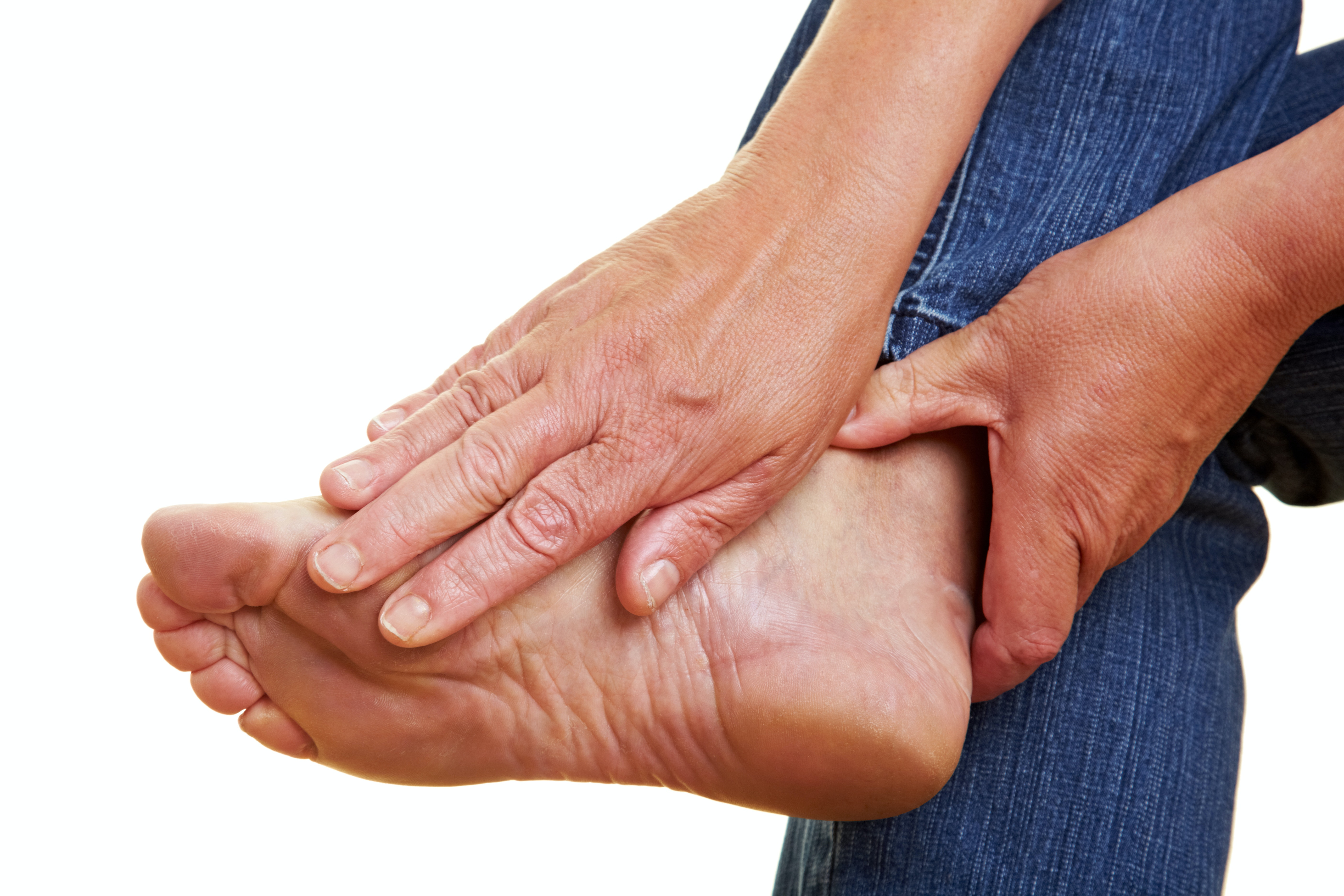 An image depicting a person suffering from sharp, stabbing foot pain symptoms