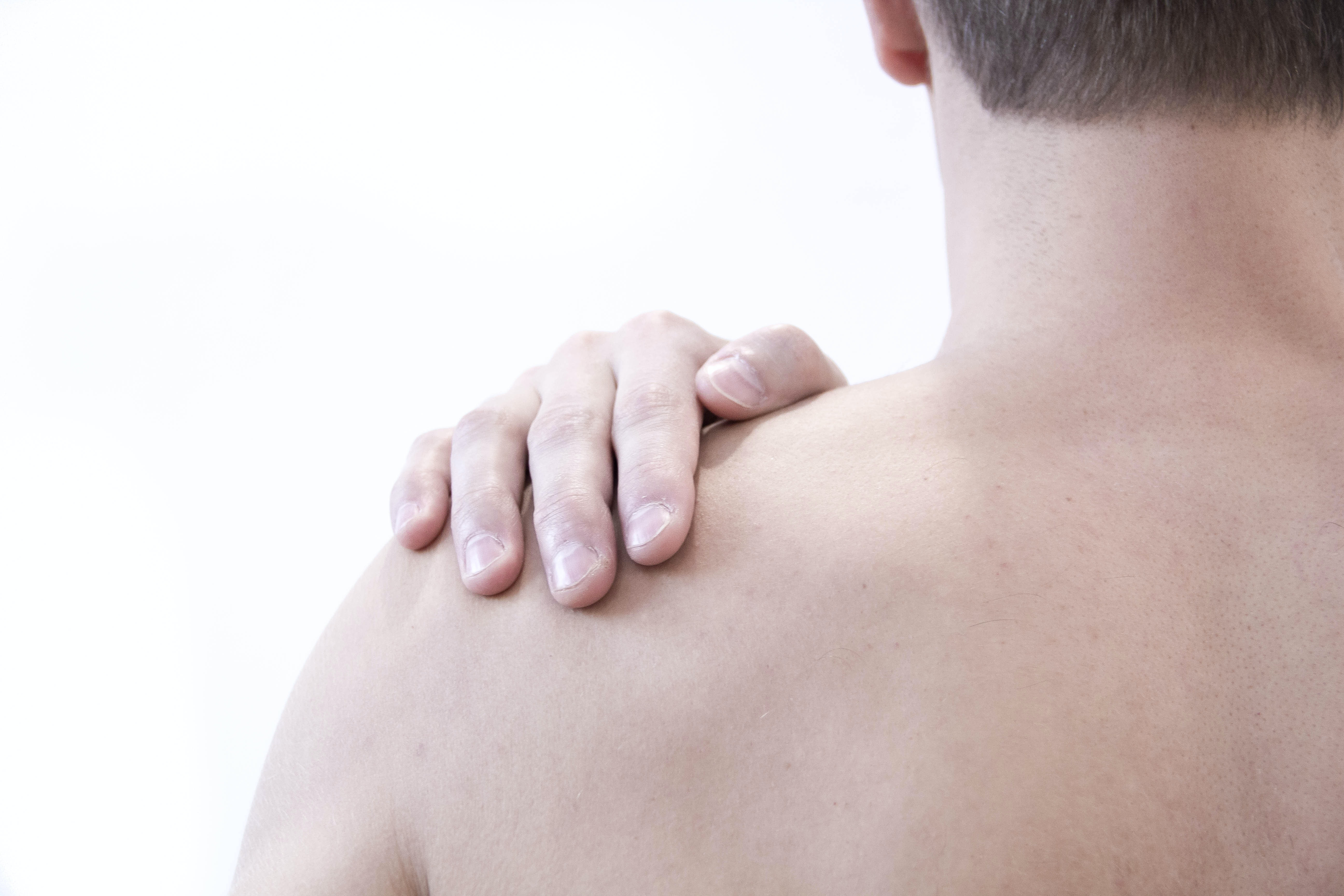 An image depicting a person suffering from shoulder bump symptoms