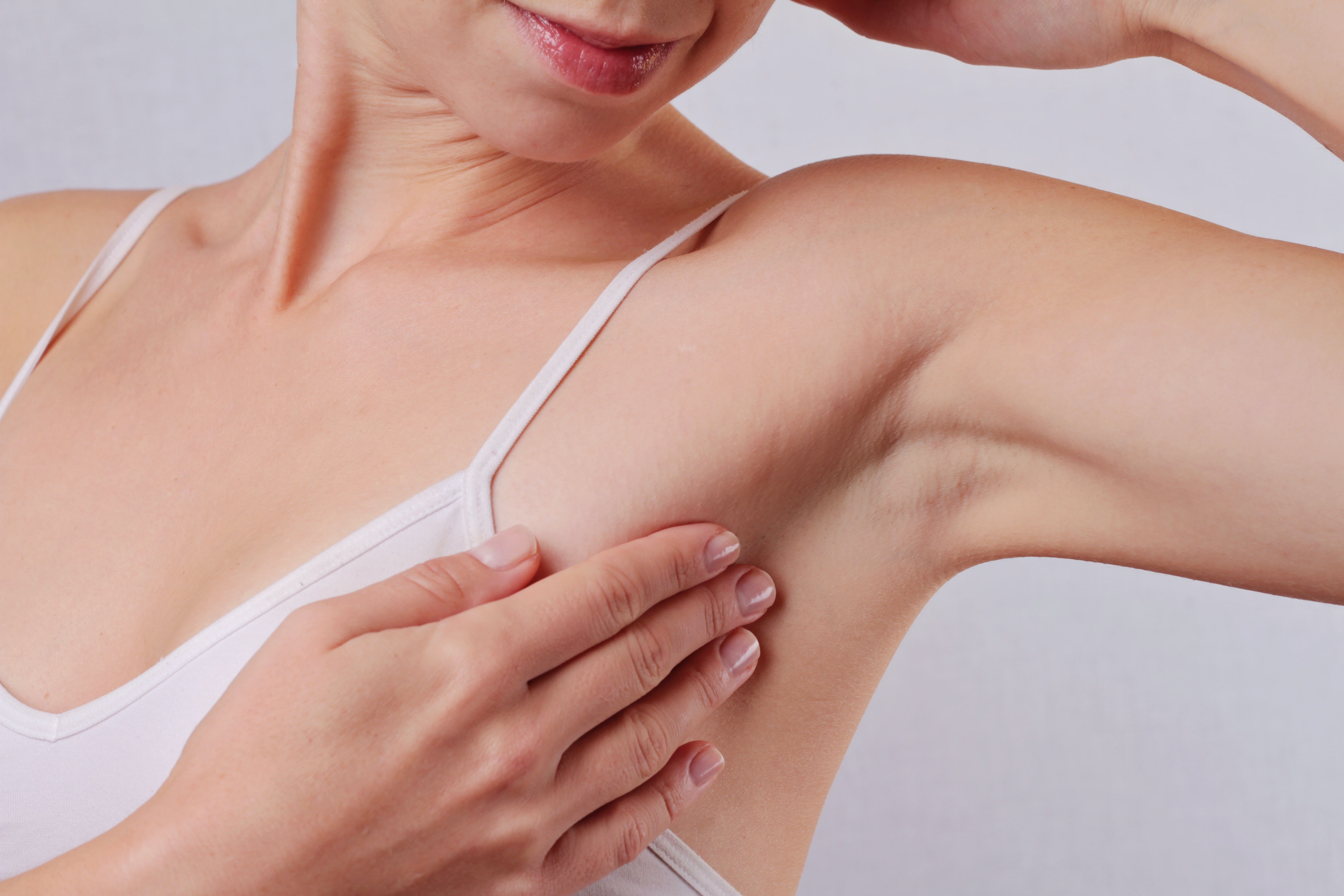 An image depicting a person suffering from skin changes on armpit symptoms