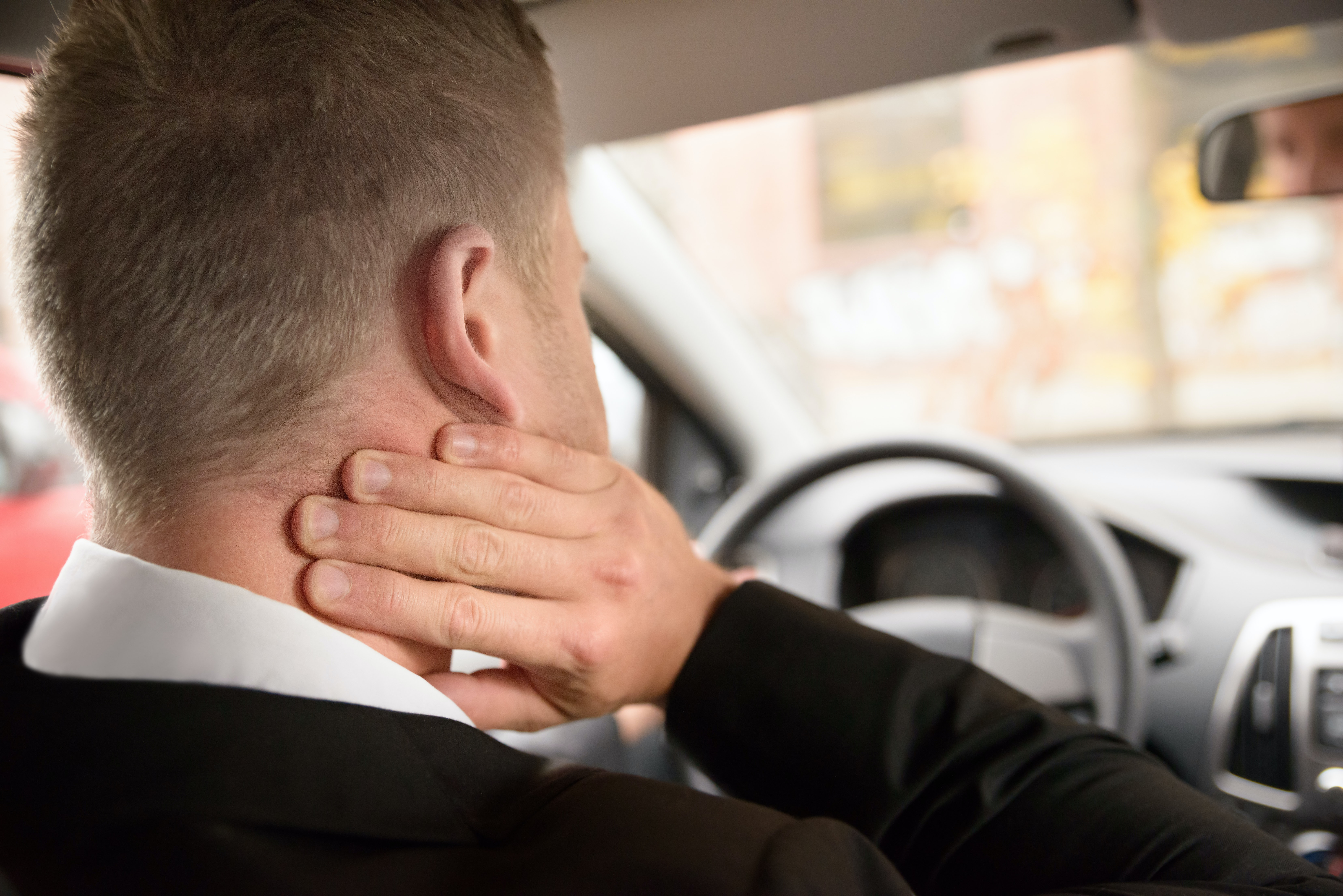 An image depicting a person suffering from skin-colored neck bump symptoms
