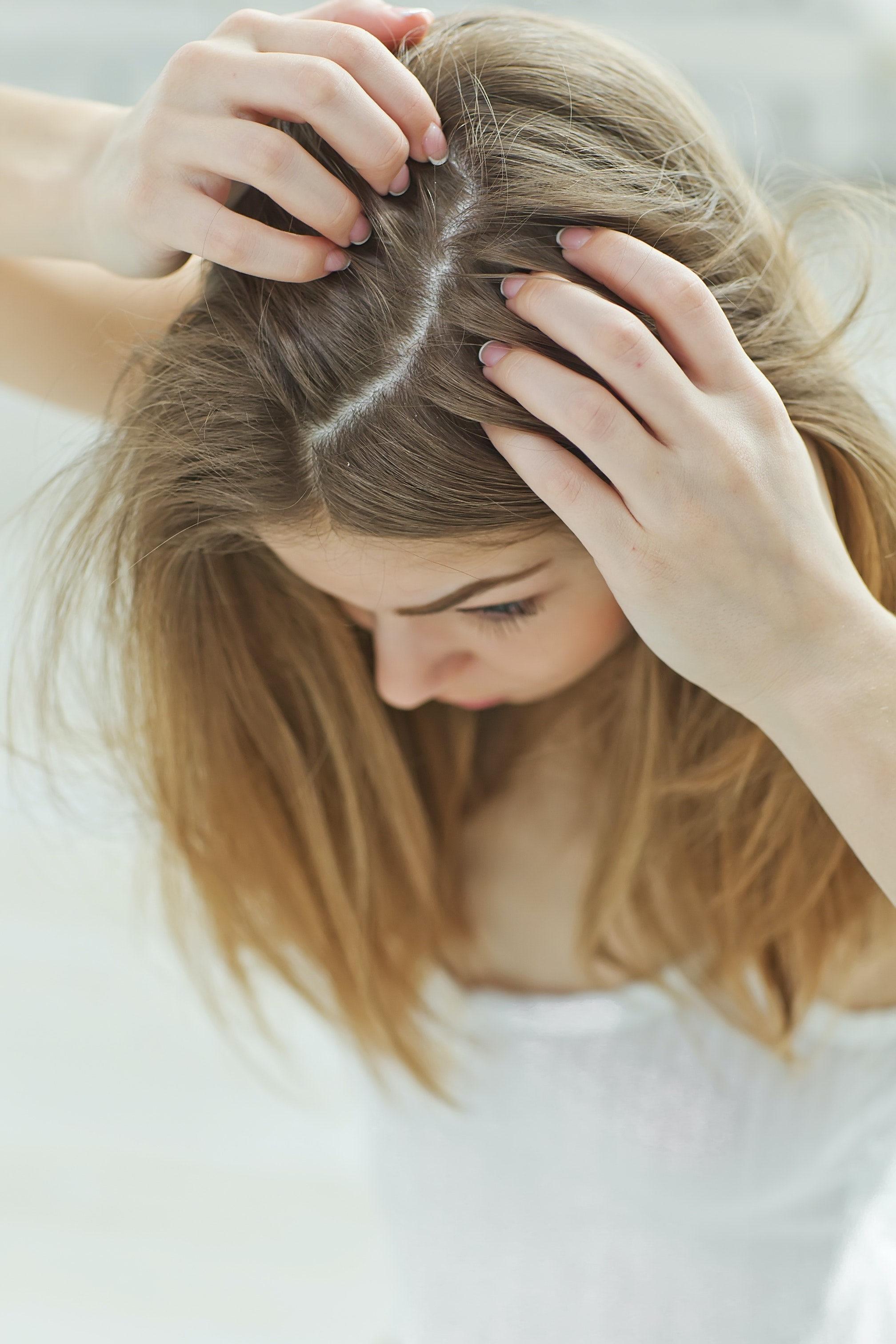 An image depicting a person suffering from soft scalp lump symptoms
