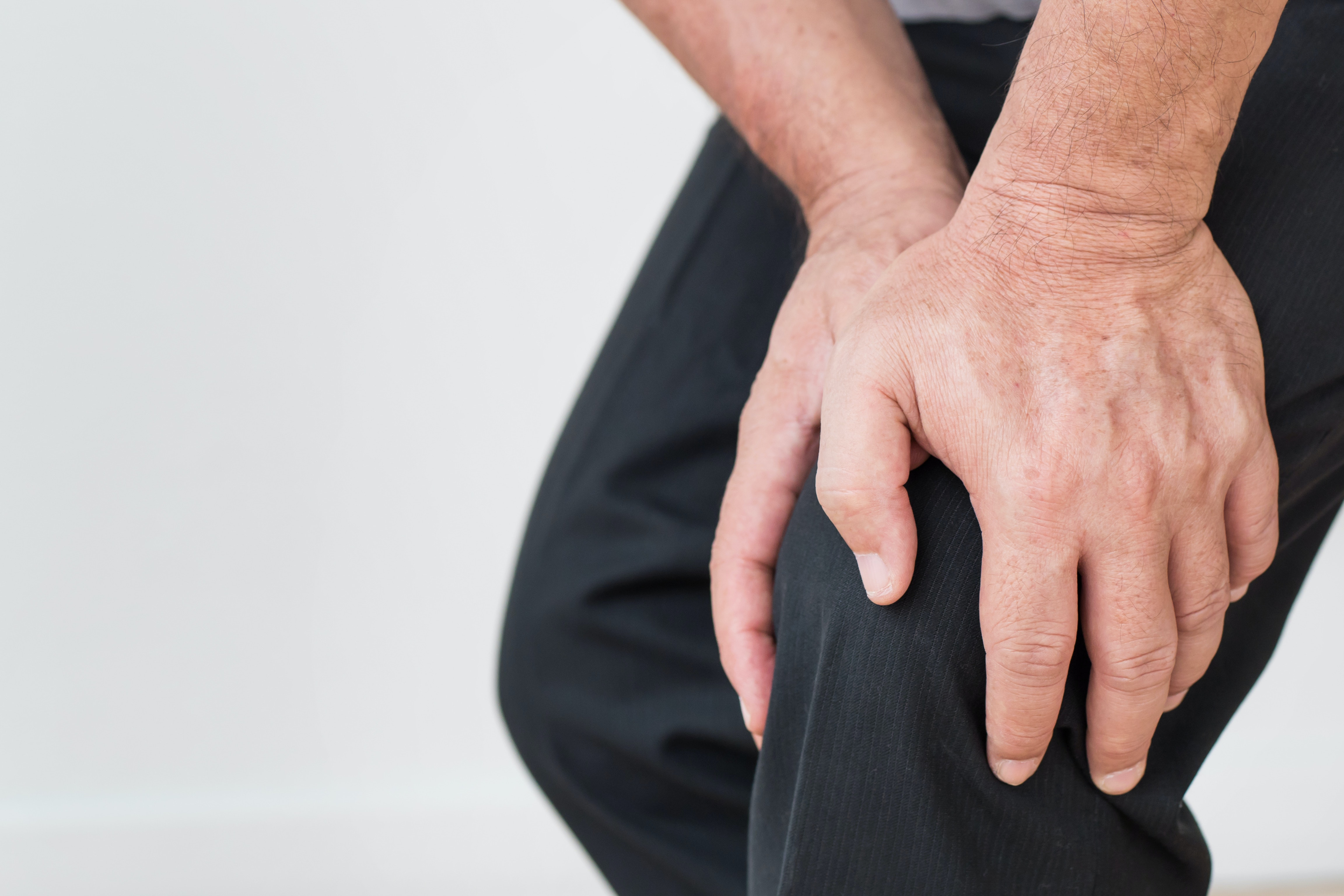 An image depicting a person suffering from spontaneous bone pain symptoms