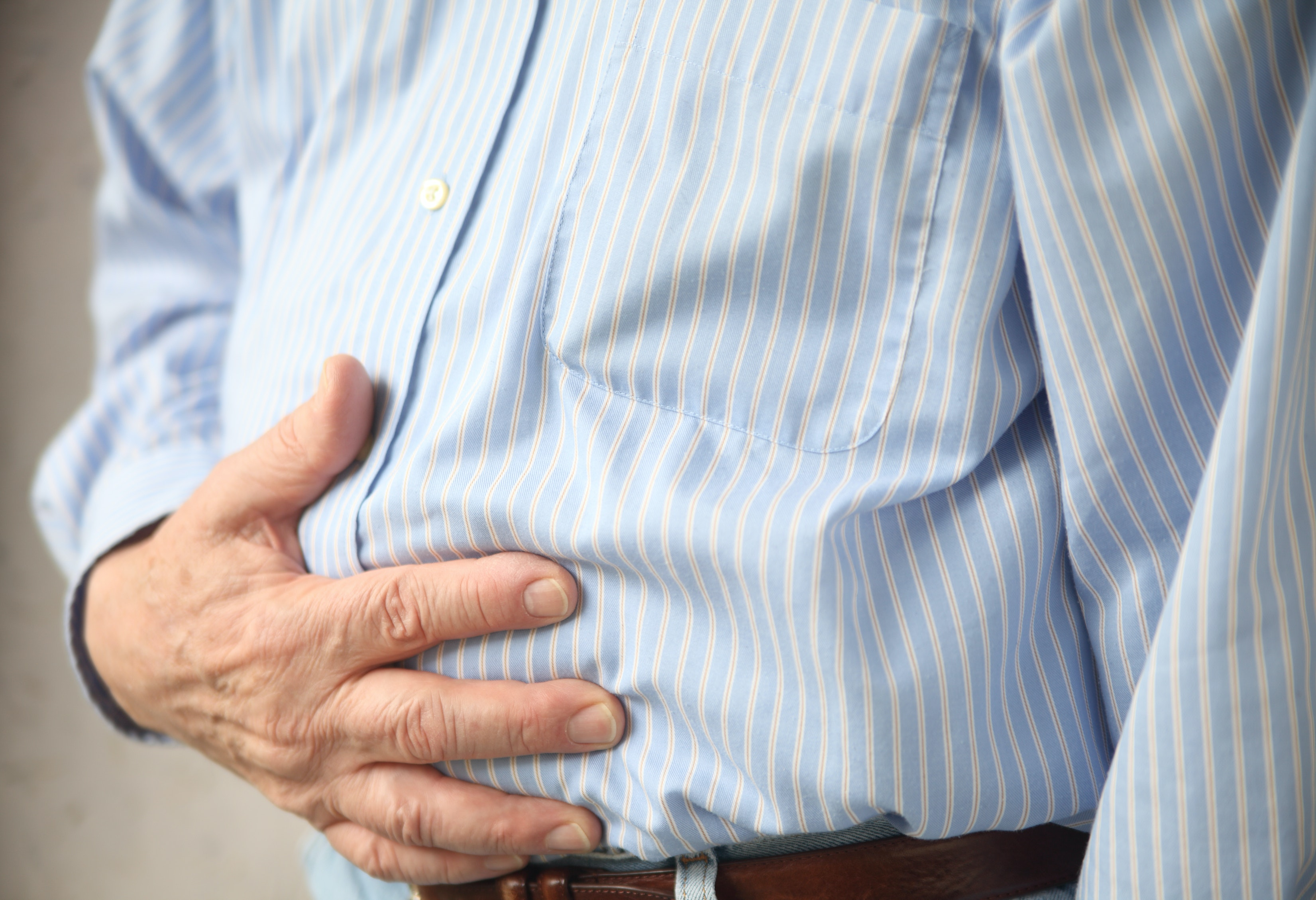 An image depicting a person suffering from stomach bloating symptoms