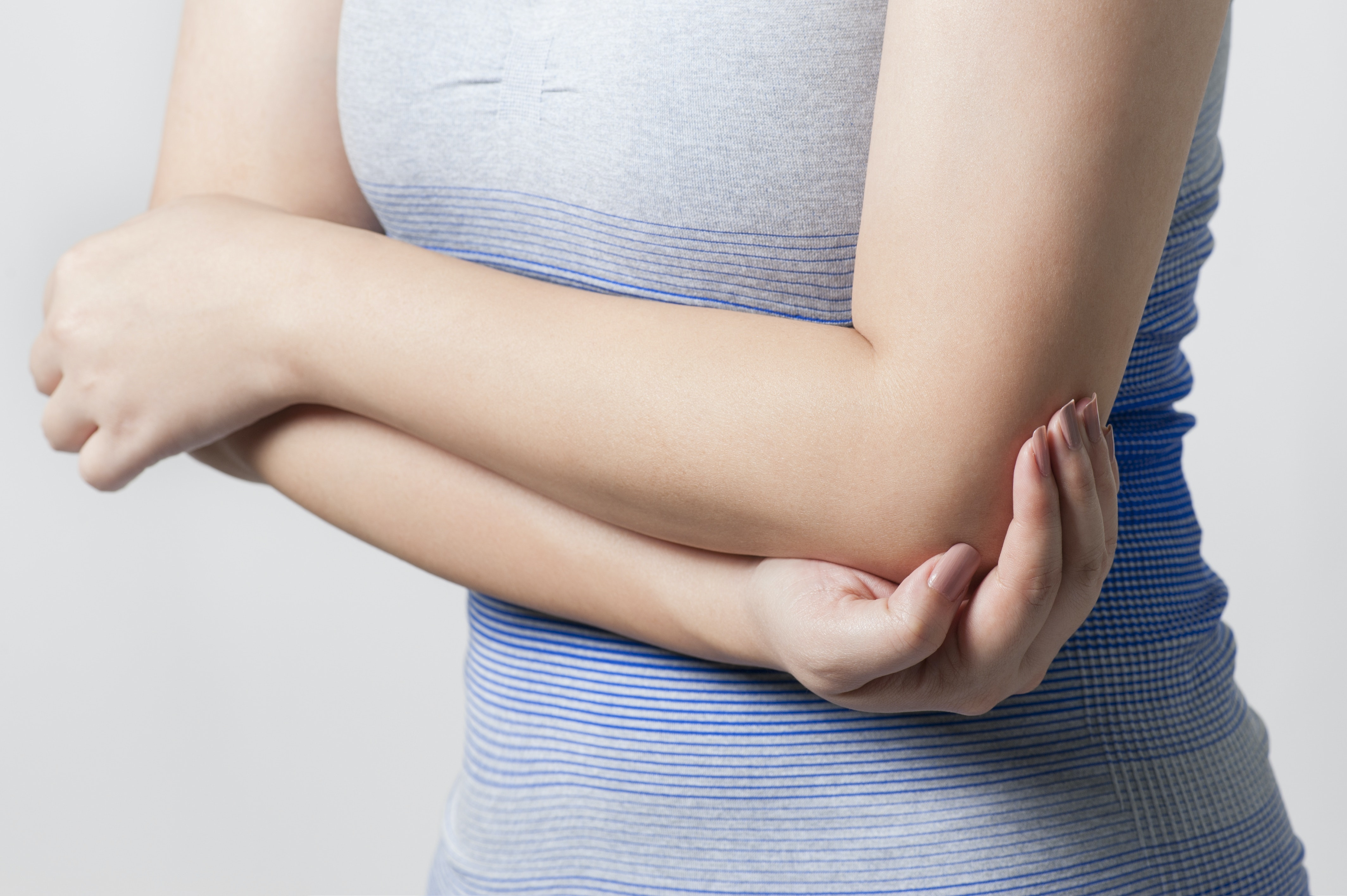 An image depicting a person suffering from swelling of both arms symptoms