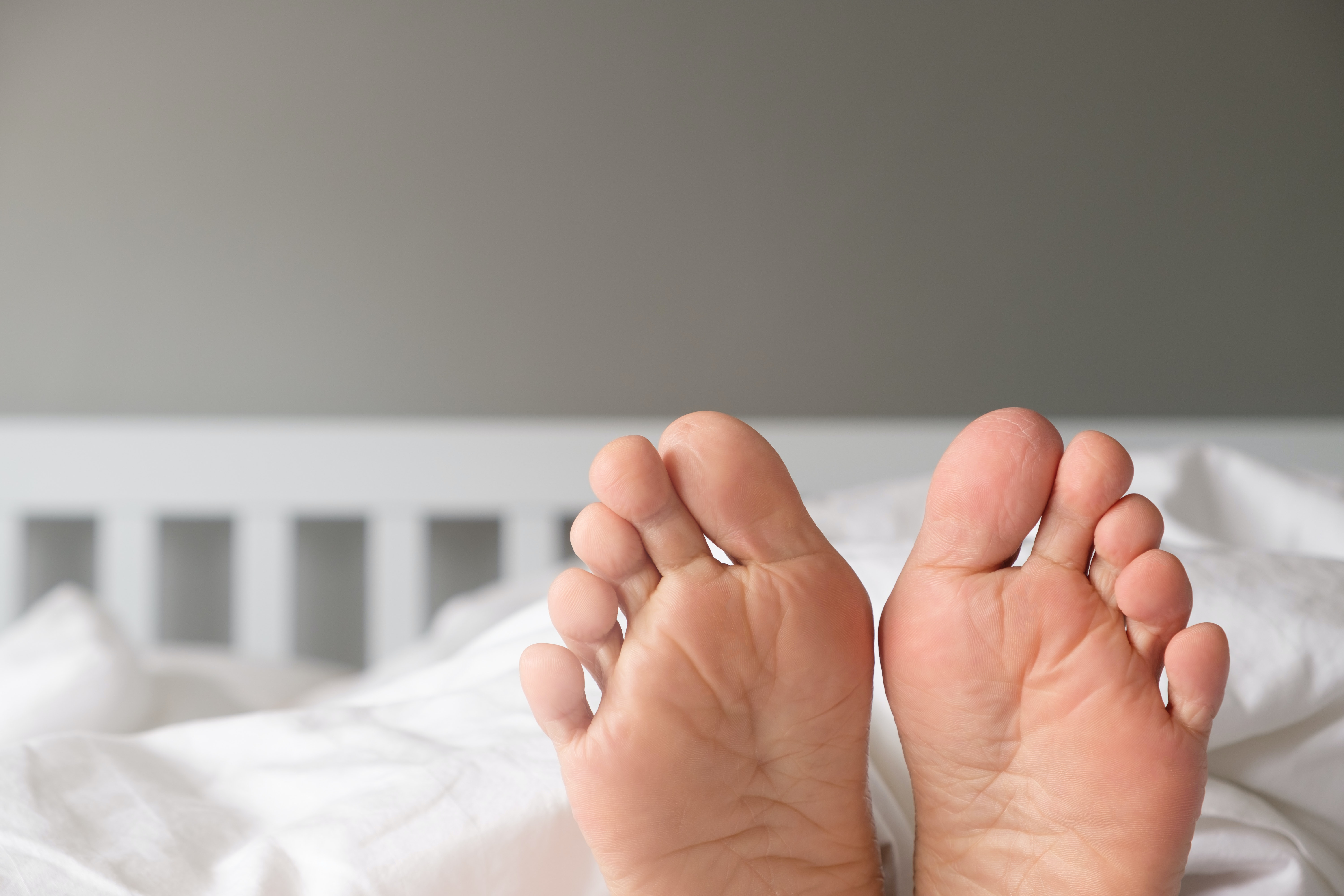An image depicting a person suffering from swelling of the 2nd, 3rd, 4th or 5th toe symptoms