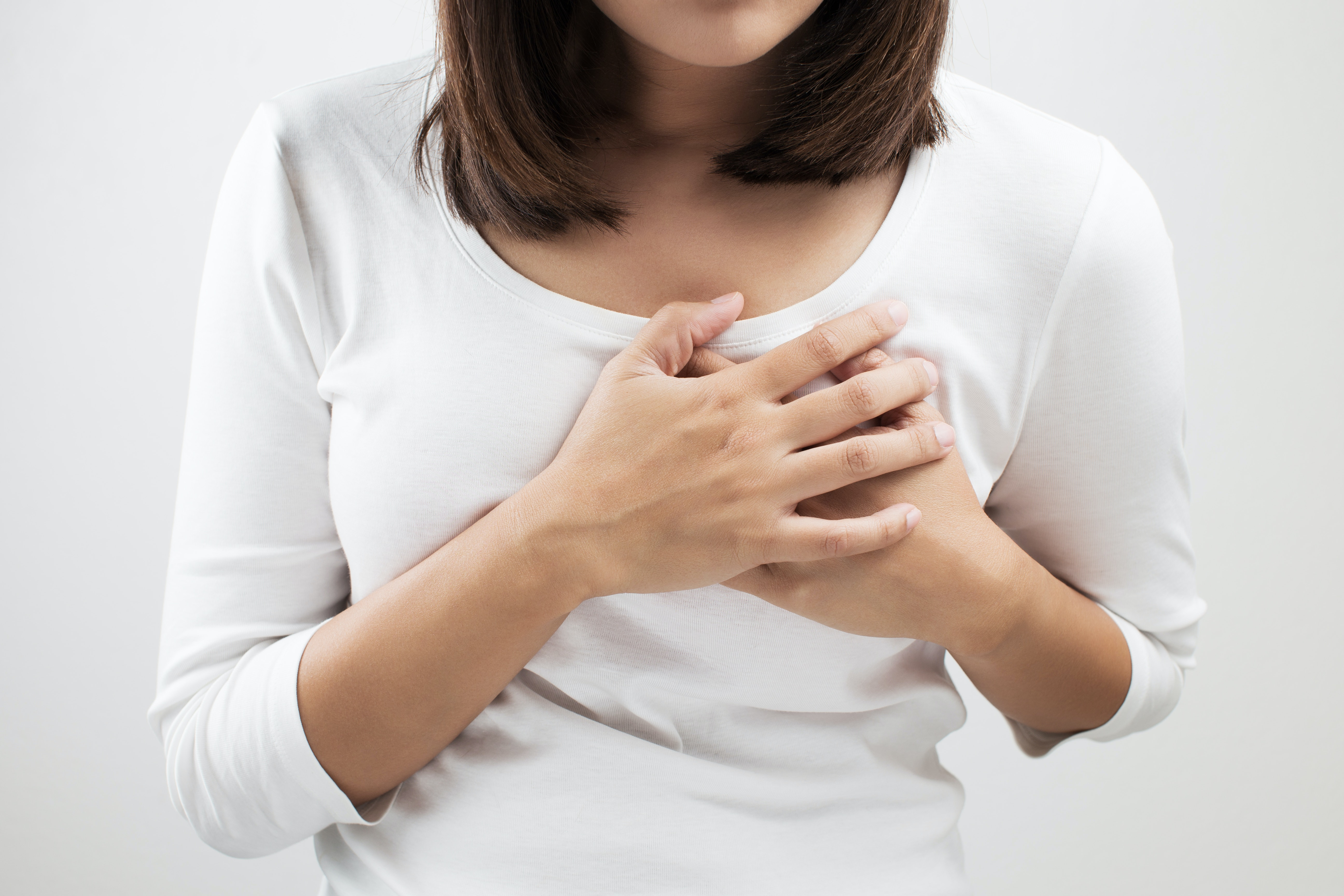 An image depicting a person suffering from swollen breasts symptoms