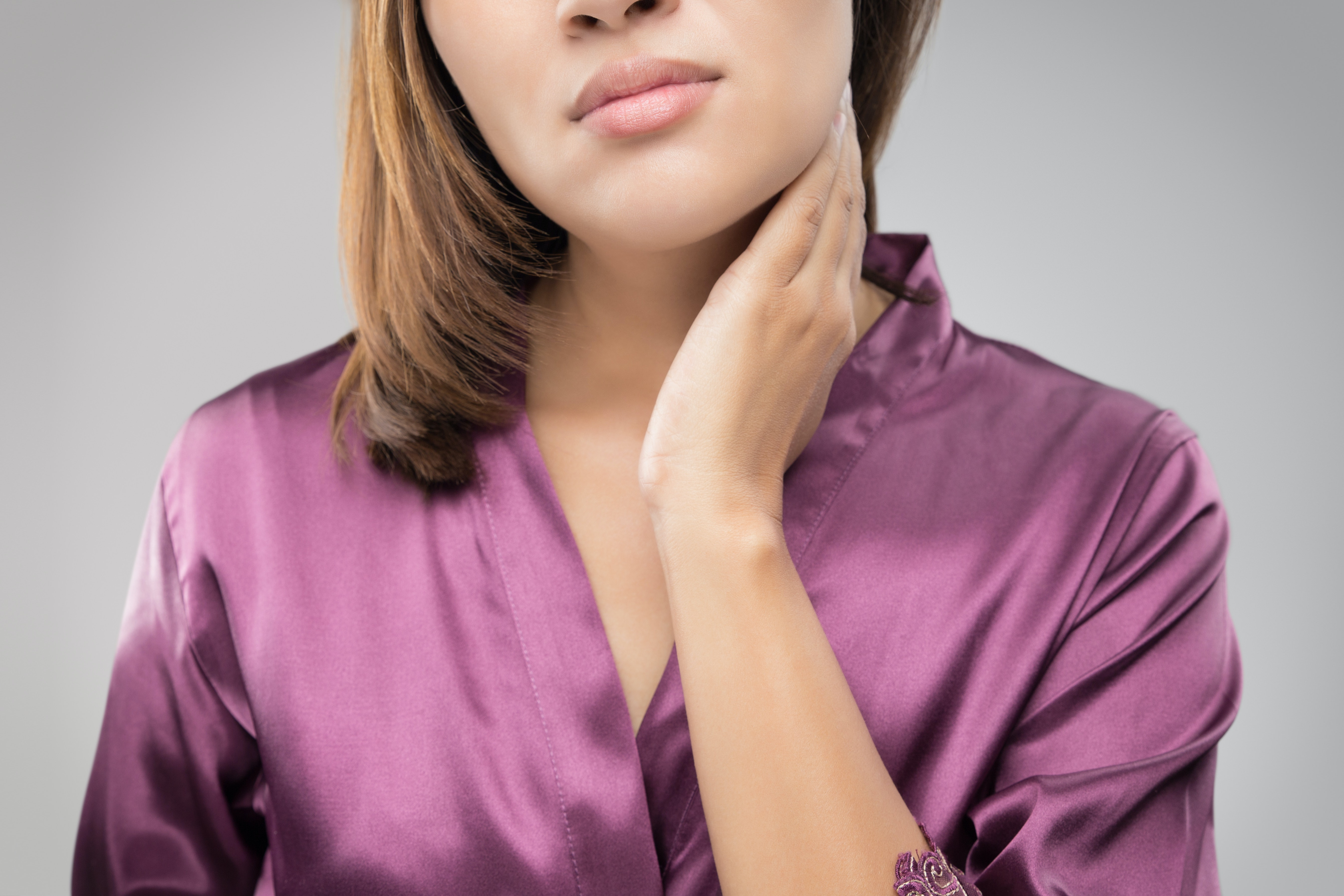 An image depicting a person suffering from swollen neck symptoms