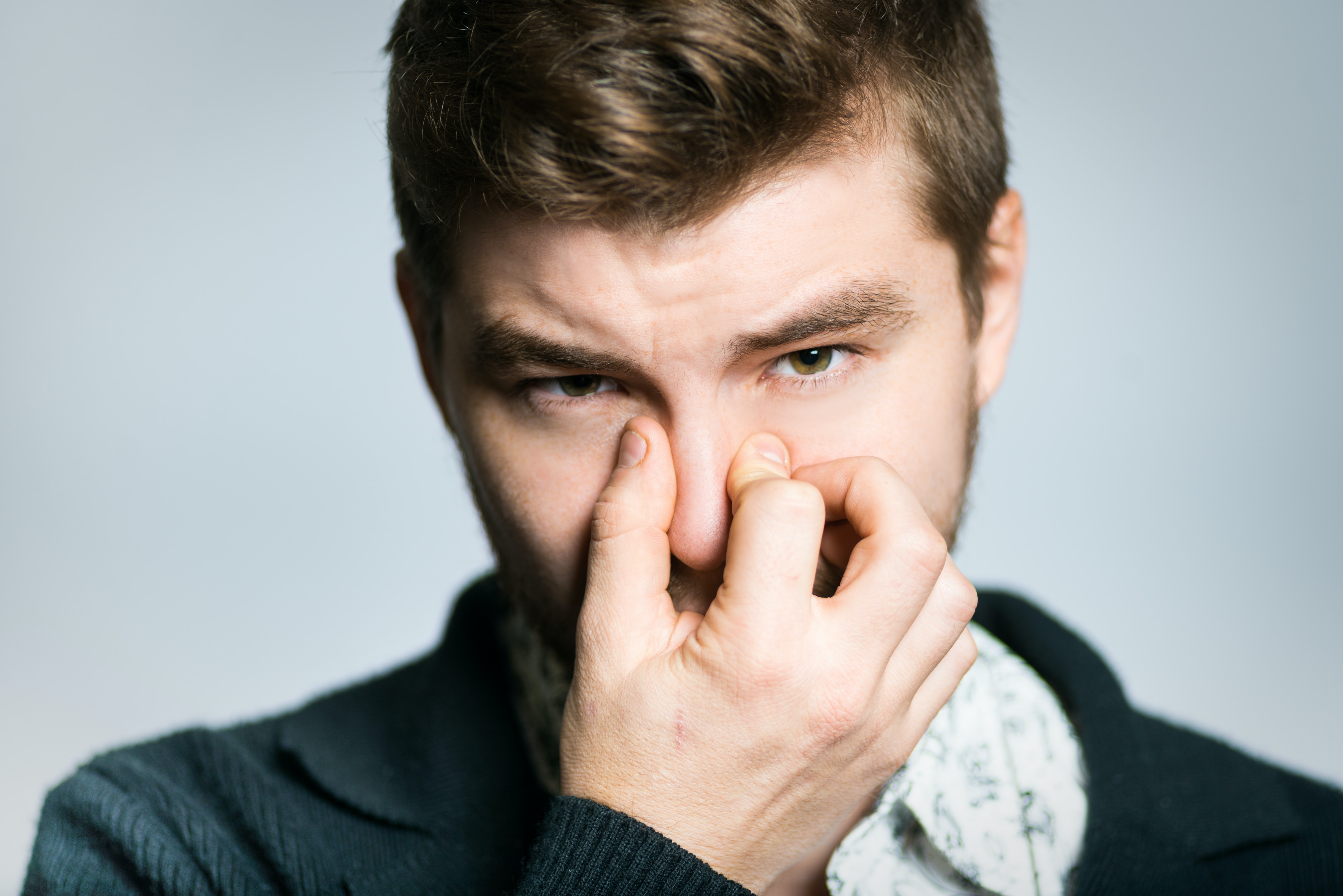 An image depicting a person suffering from swollen nose symptoms