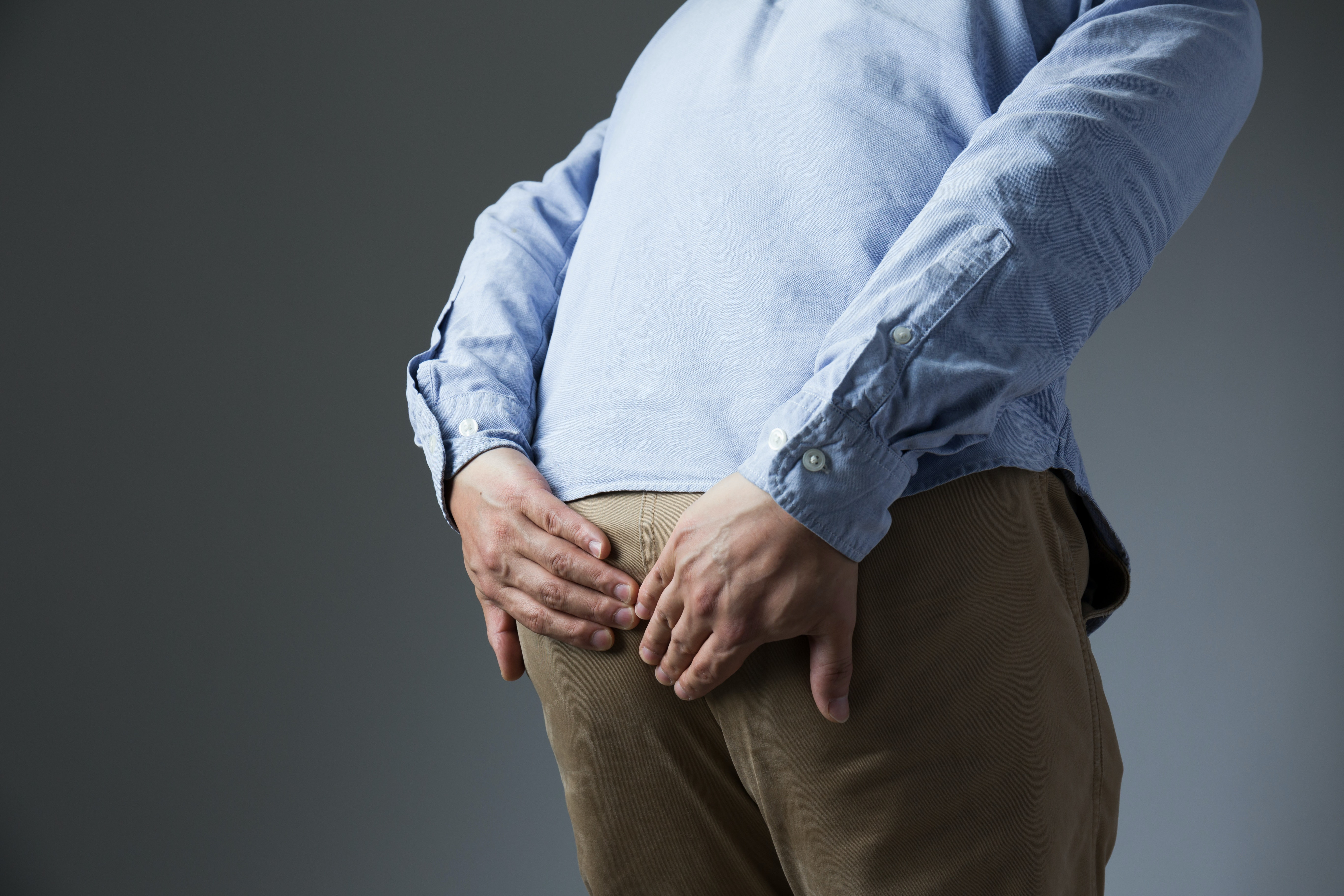 An image depicting a person suffering from tailbone pain symptoms