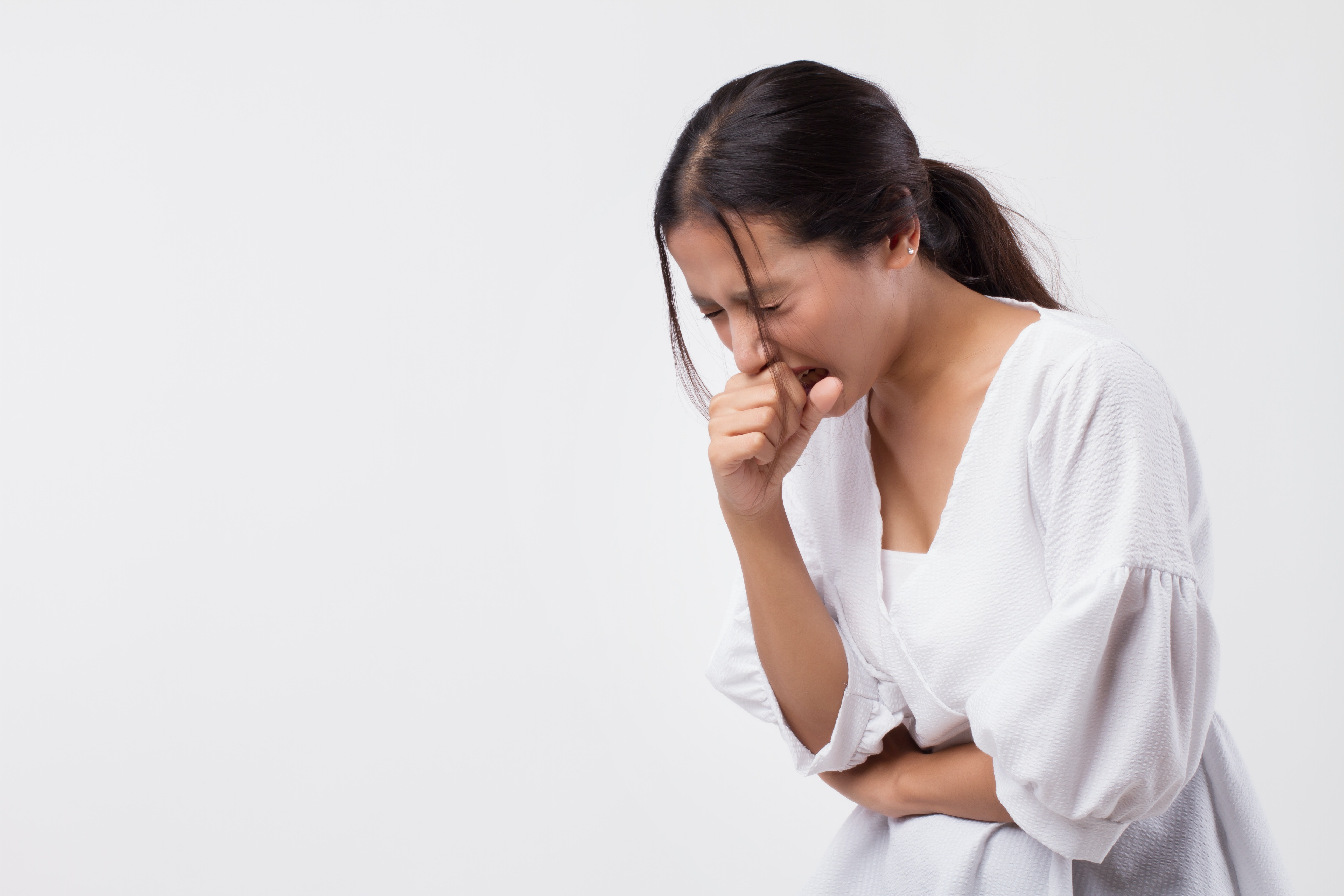 An image depicting a person suffering from throat clearing symptoms