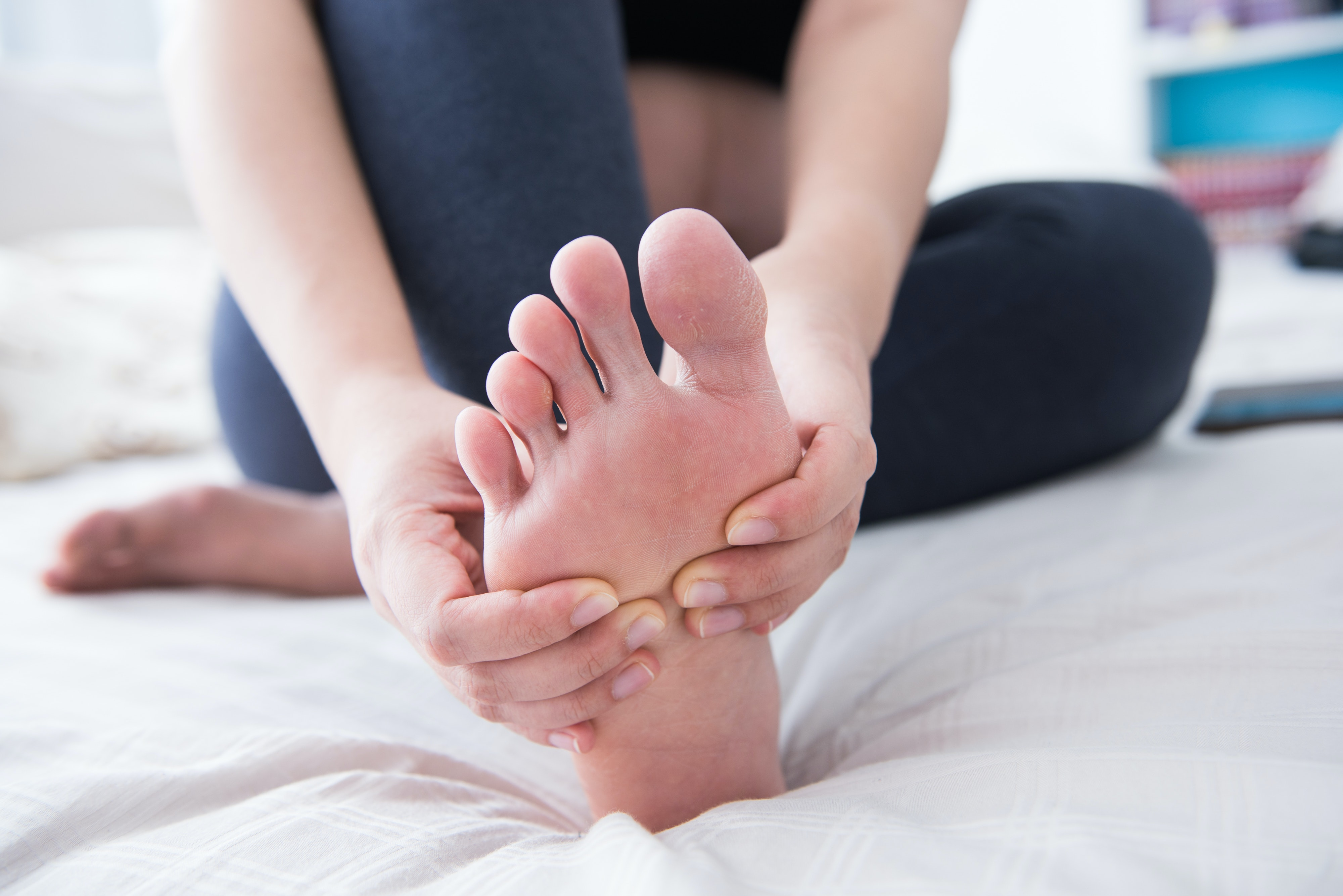 An image depicting a person suffering from tingling foot symptoms