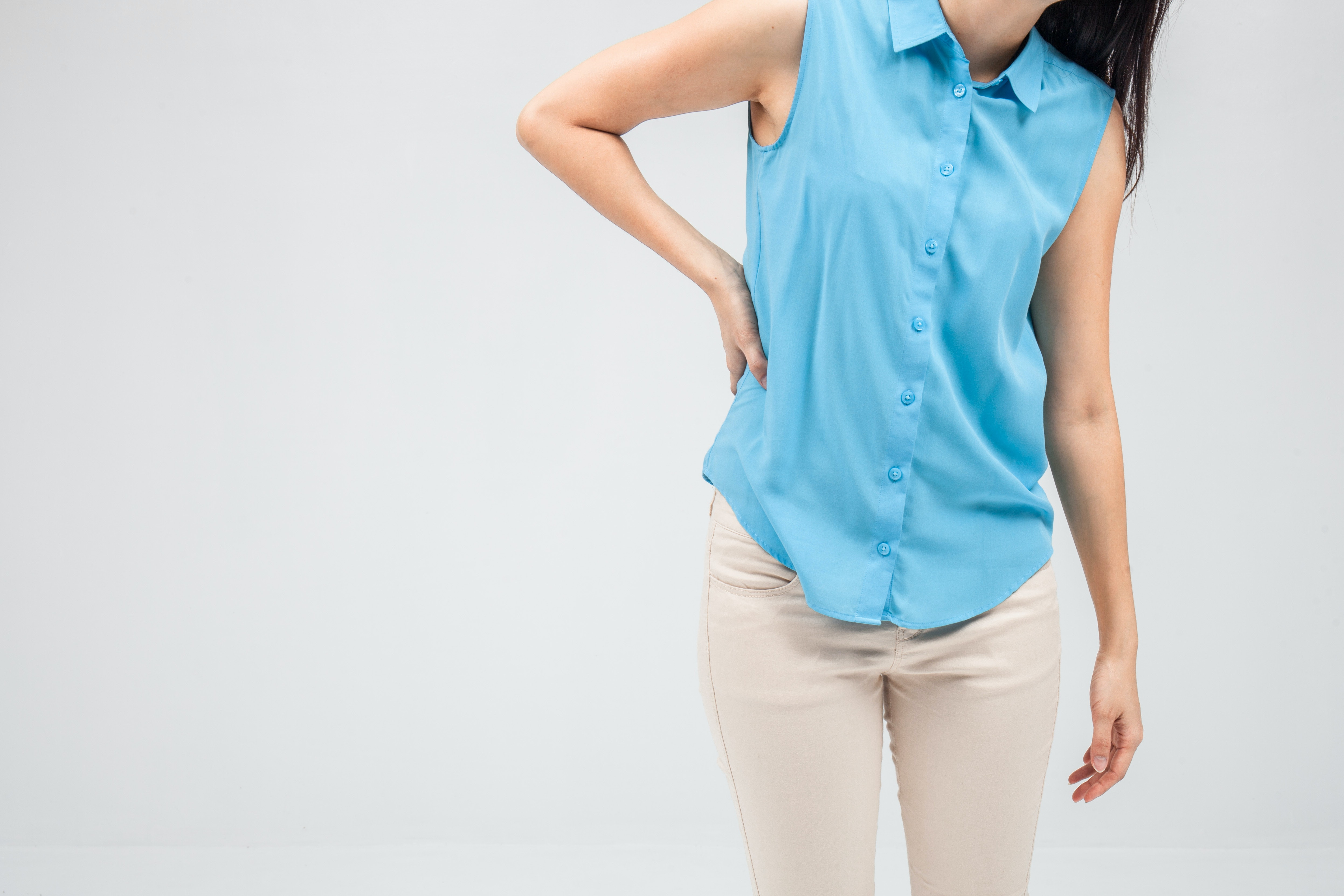 An image depicting a person suffering from tingling hip symptoms