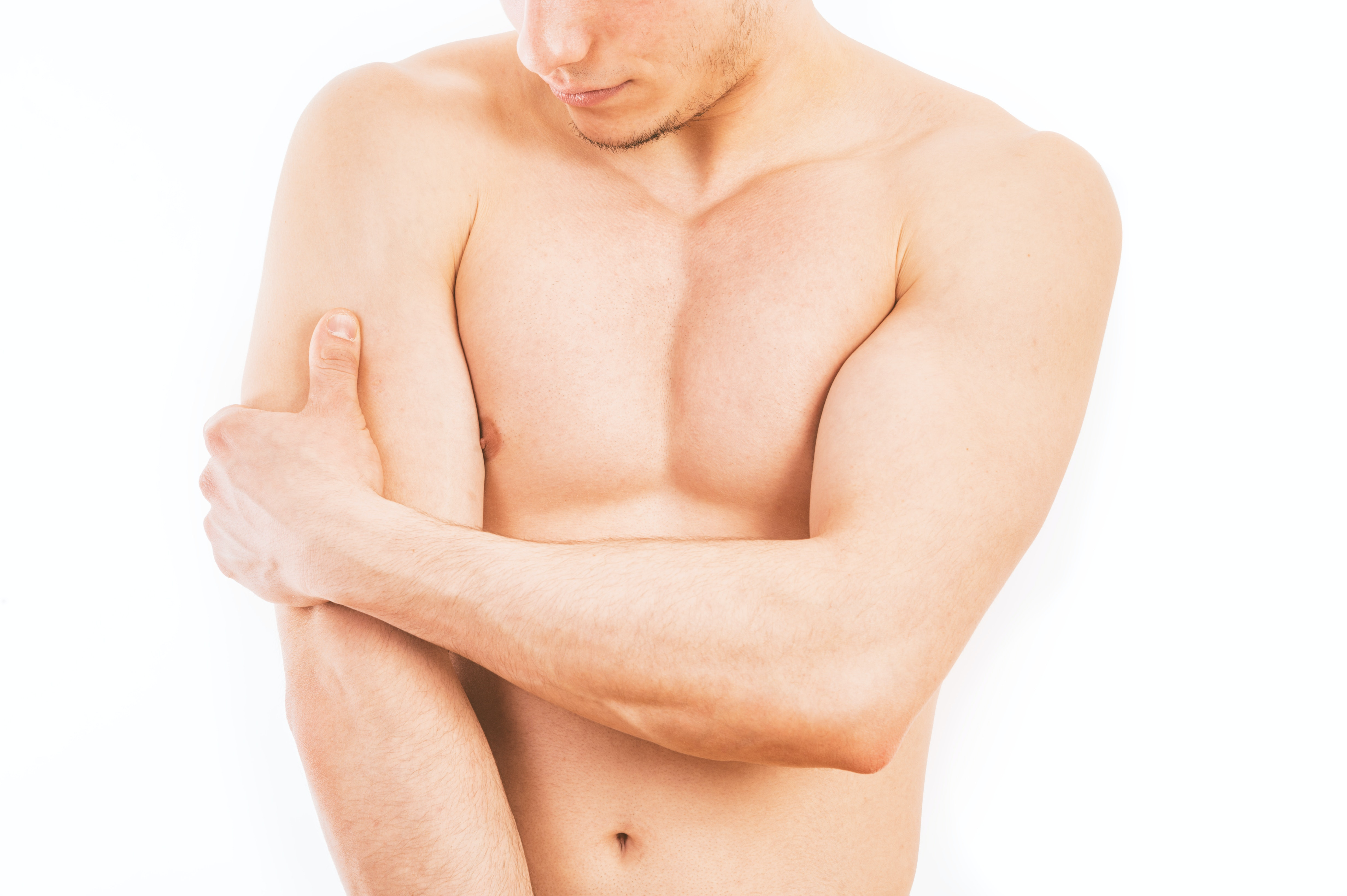 An image depicting a person suffering from tricep pain symptoms