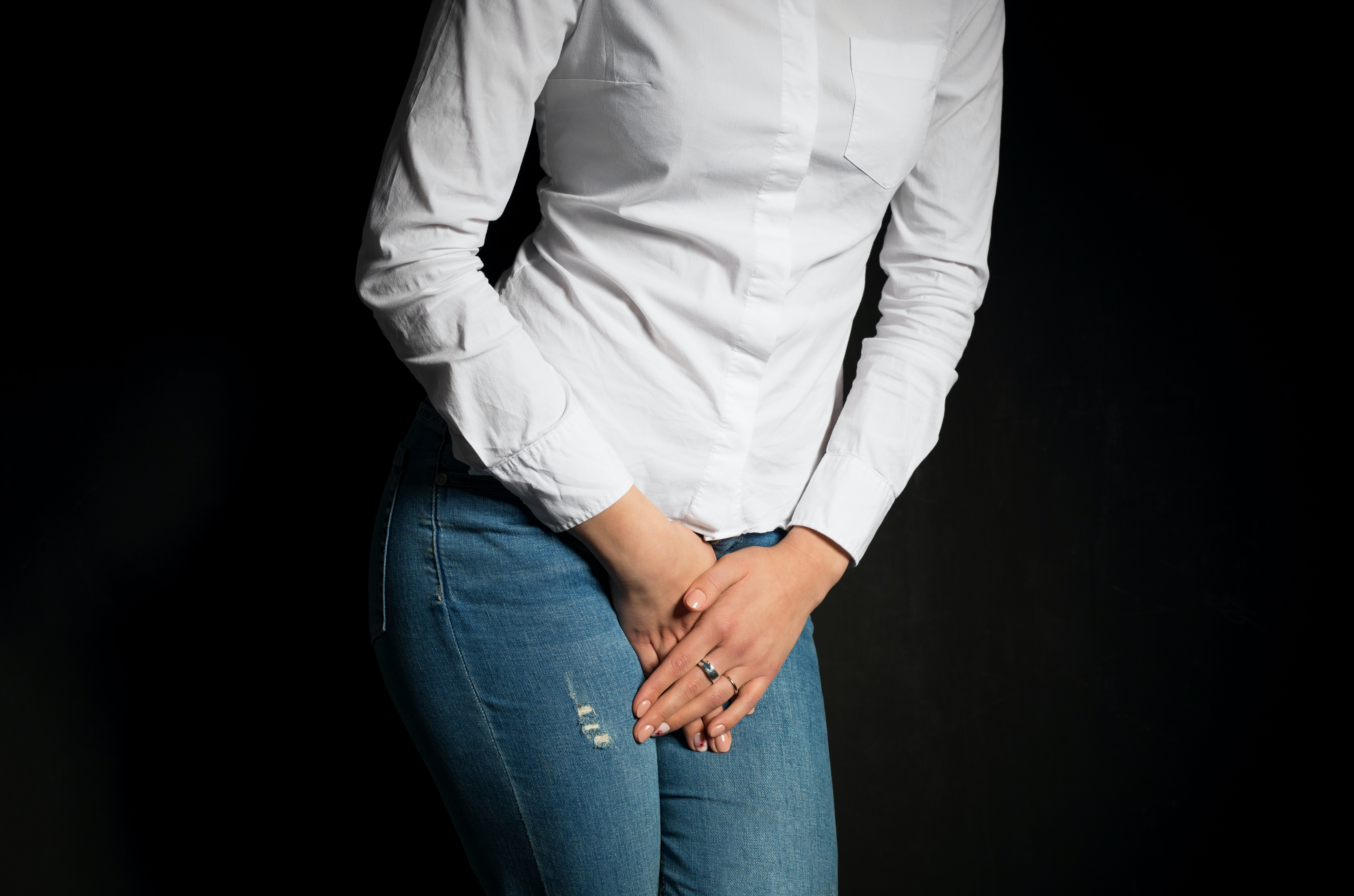 An image depicting a person suffering from vaginal pain symptoms