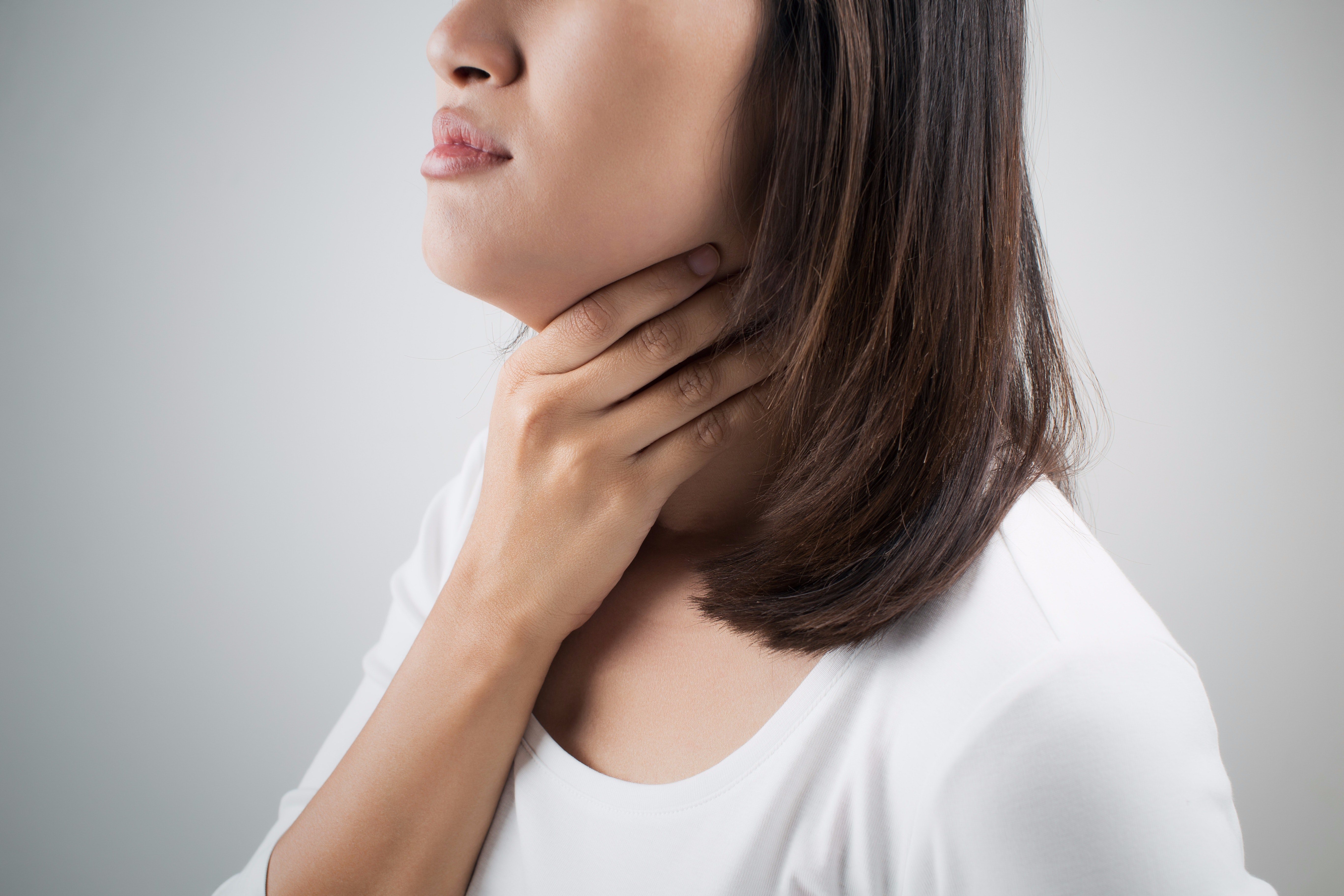 An image depicting a person suffering from Viral Throat Infection symptoms