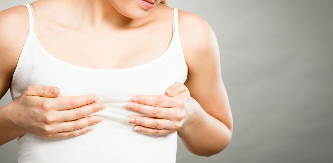 An image depicting a person suffering from white or clear fluid leaking  from the breast symptoms