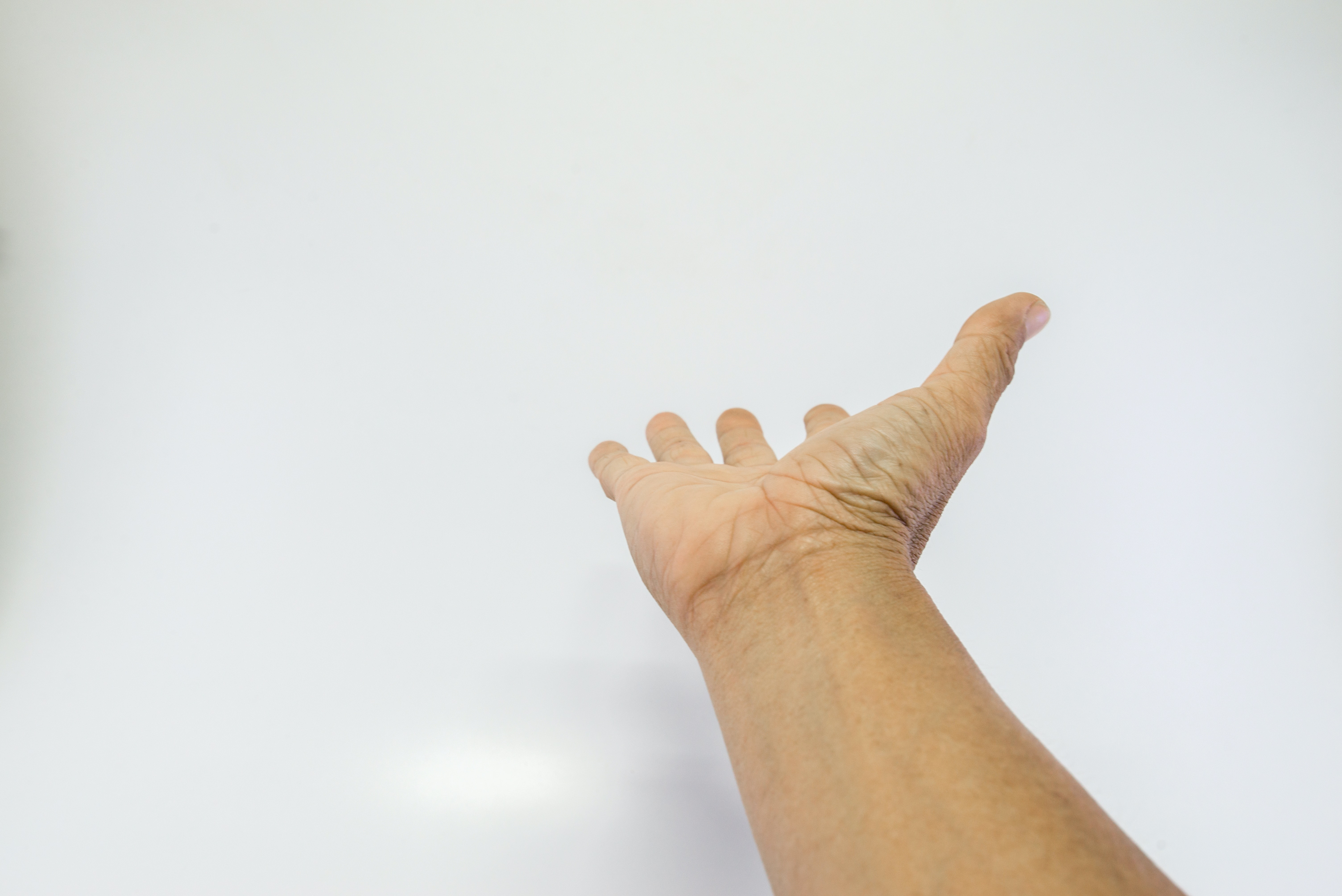An image depicting a person suffering from wrist skin changes symptoms