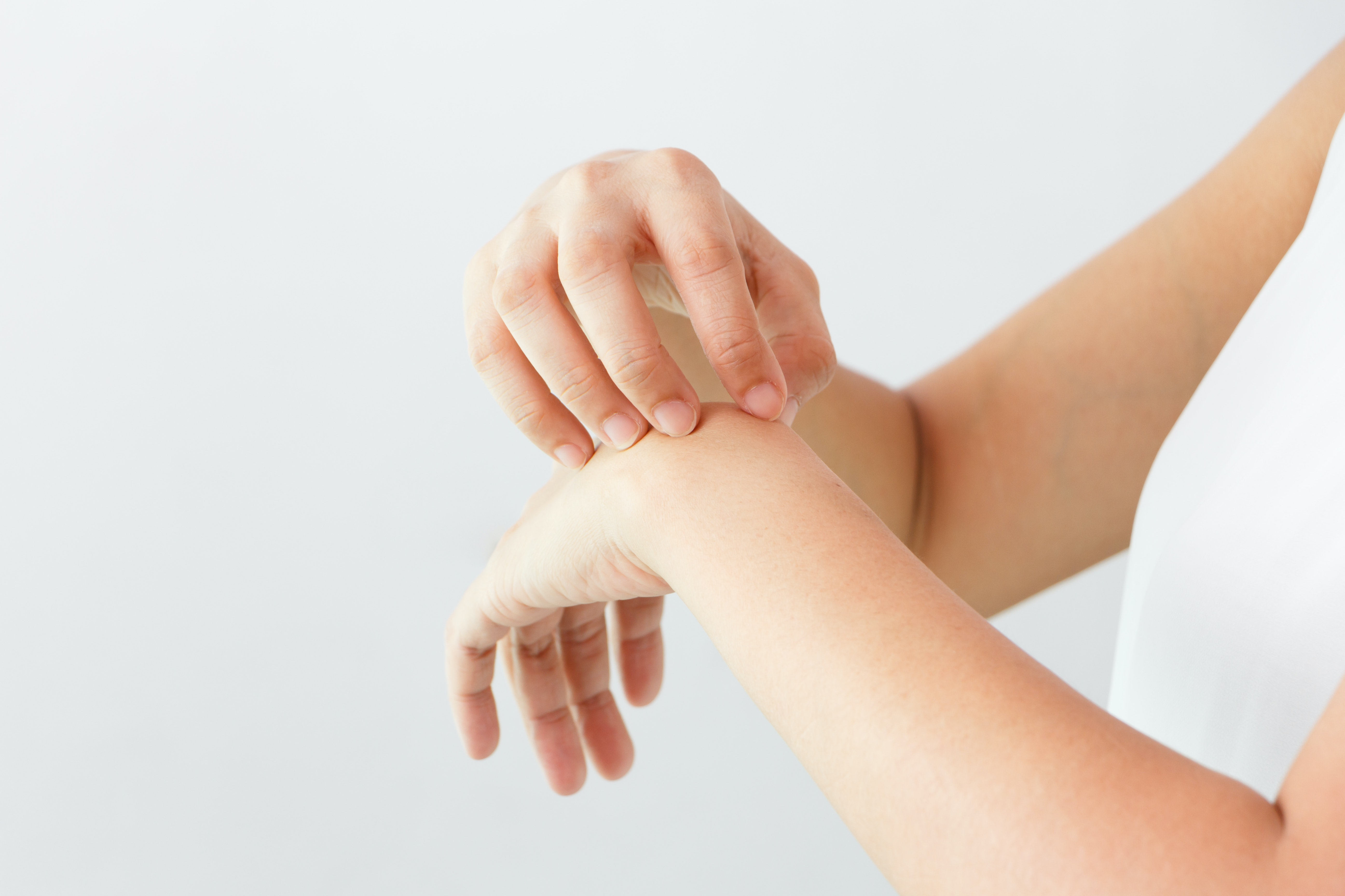 An image depicting a person suffering from wrist weakness symptoms